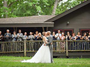 Bride and Groom Kissing at Camp Woodbury