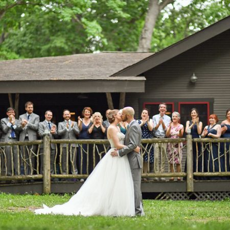 Bride and Groom Kissing at Camp Woodbury