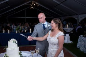 Bride and Groom Cut the Cake at Wedding Reception