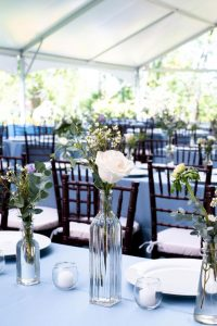 white rose centerpieces provided by Maureen's Floral Design